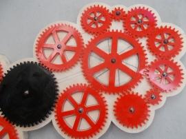 The largest black cog (left) Diameter 12cm and smallest red cog diameter 2cm